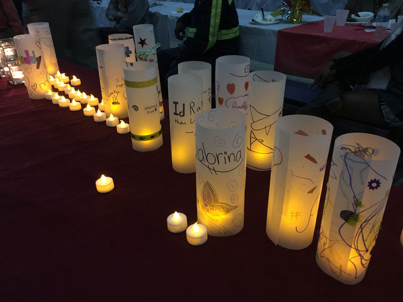Dozens of smaller candles and several large candles, which the children decorated