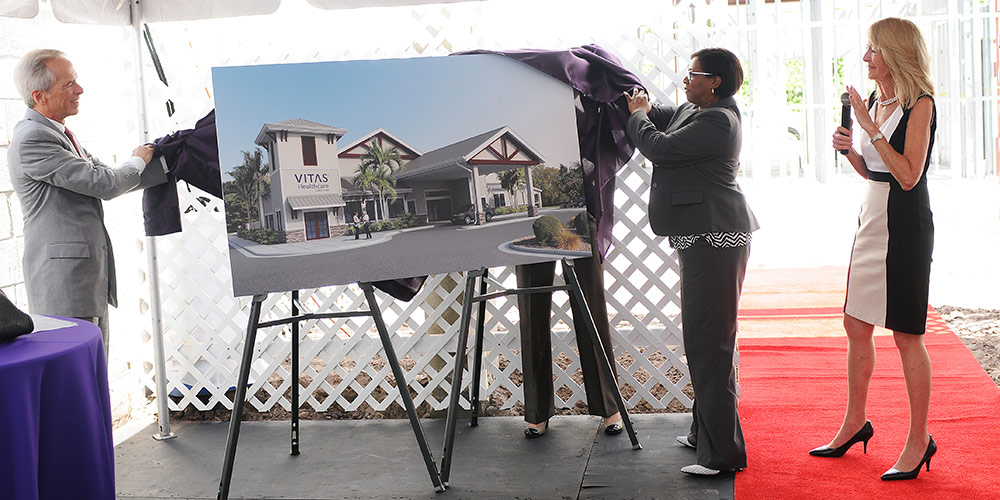 Unveiling a rendering at the Delray Beach groundbreaking