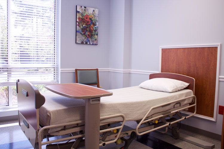 A bed in a patient room