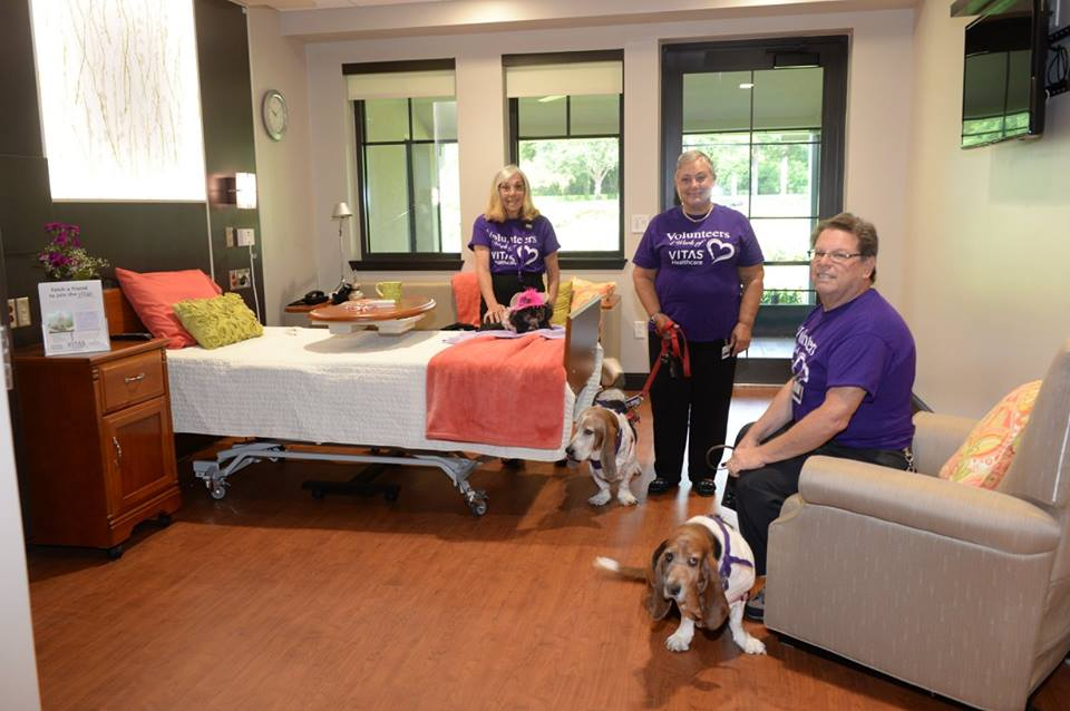Three Pet Paws volunteers with their dogs, two beagles and a toy breed