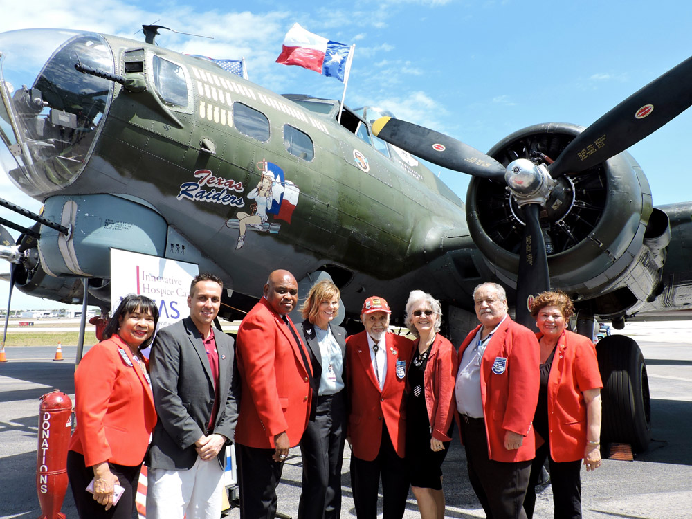 The group stands in front of the Texas Raiders  Boeing B-17 Flying Fortress