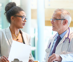 A case manager talks with a physician