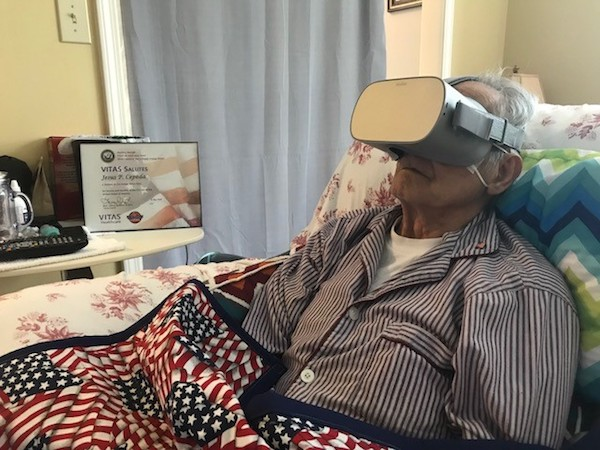 Cepeda wears the virtual reality goggles in bed