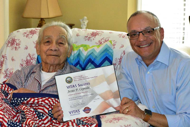 Cepeda smiles as he receives his certificate from Robert