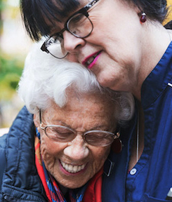 A patient embraces a nurse