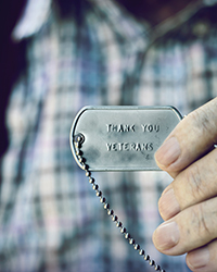 A military dog tag that says Thank You Veterans