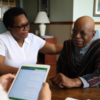 A caseworker talks with a patient