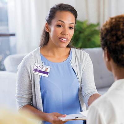A VITAS social worker speaks with a physician