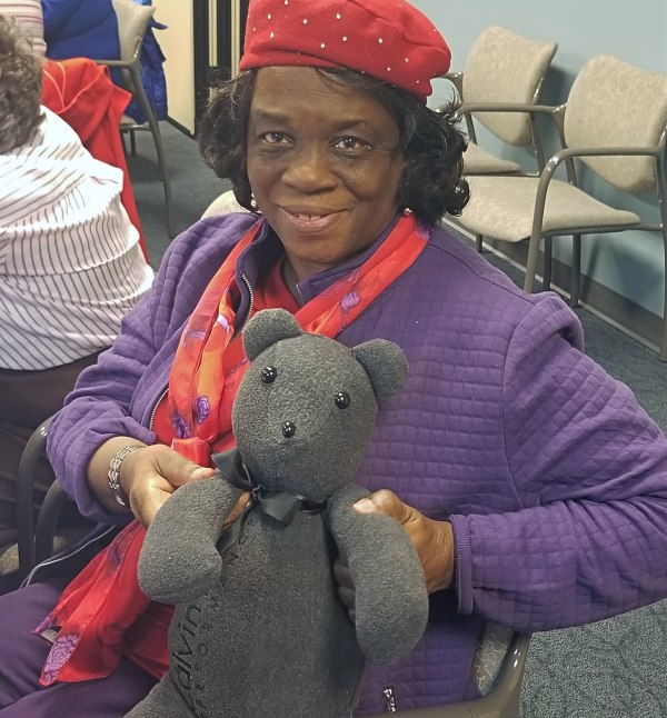 A woman holds a Memory Bear at a reunion in Chicago