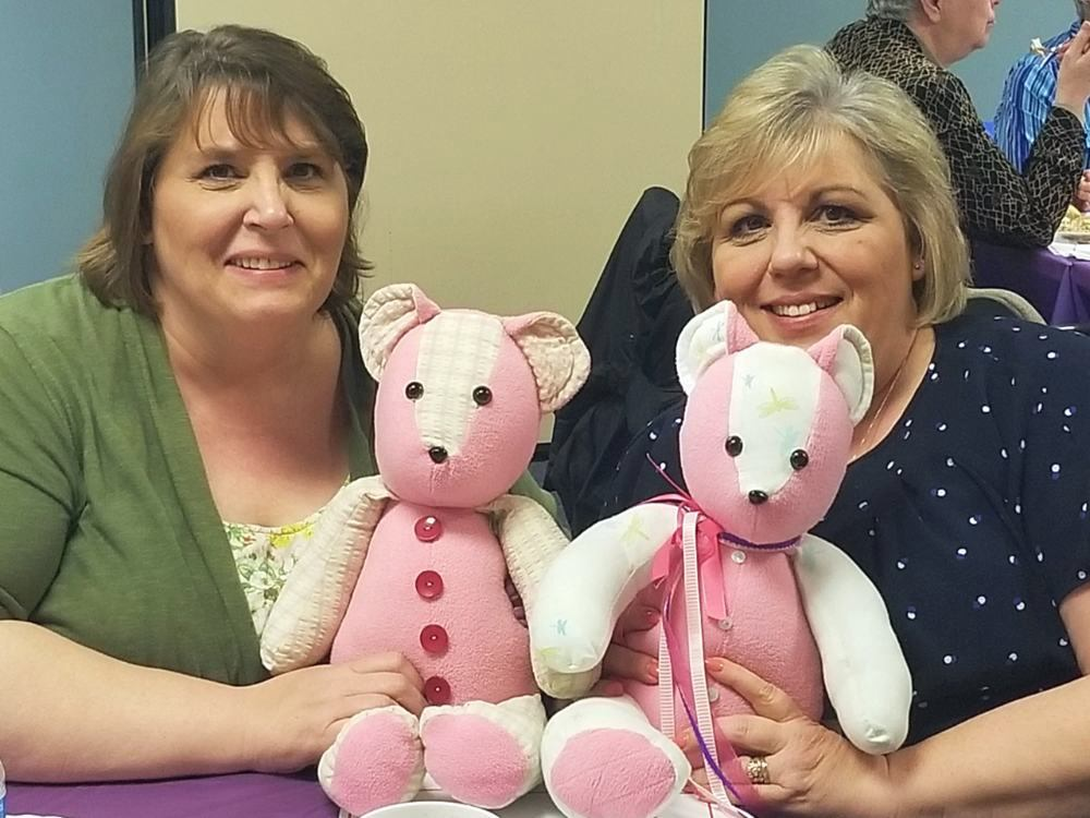 Two women hold their Memory Bears