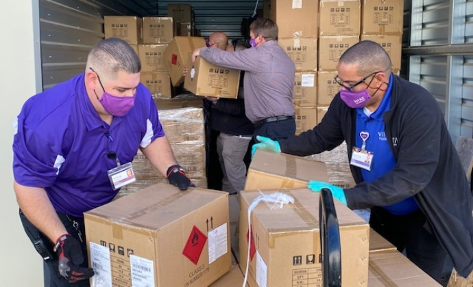 VITAS HME team members unload boxes of supplies from a truck