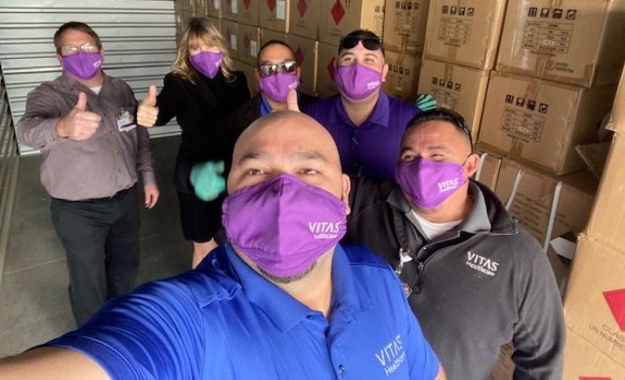 VITAS HME team members pose for a selfie with a truckload of supplies