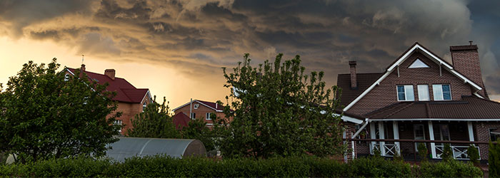 Storm clouds loom over a neighborhood