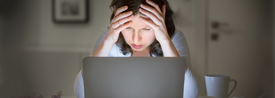 Woman frustrated looking at her computer