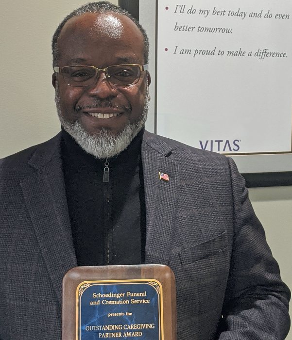 Mark Haynes holds a plaque commemorating his award