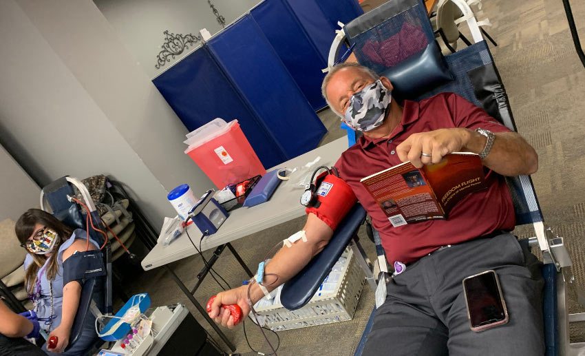 Two VITAS employees donate blood at the program office