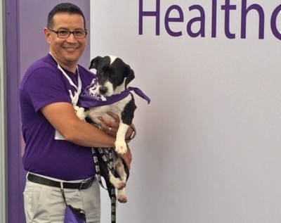 Volunteer Manager Alex Silva and his dog, Moose