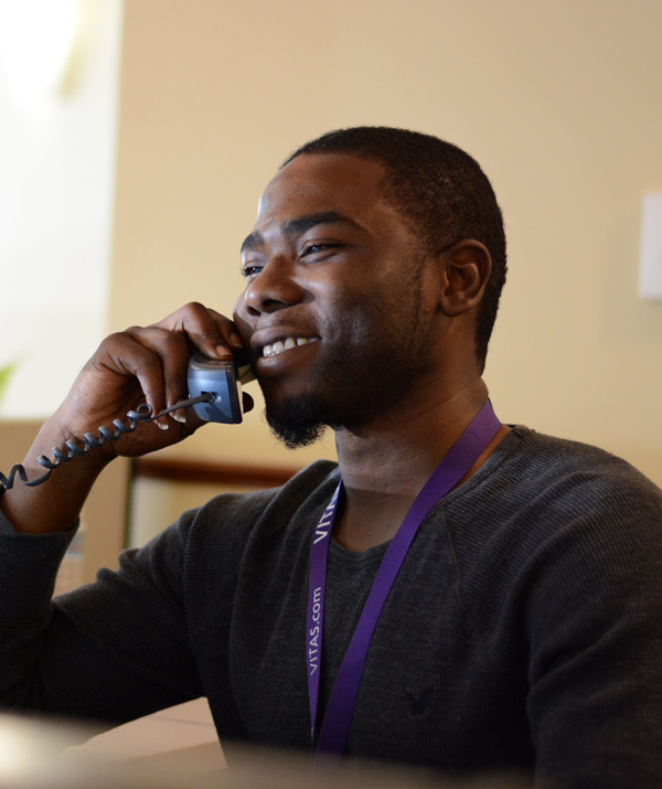 A VITAS team member answers a call