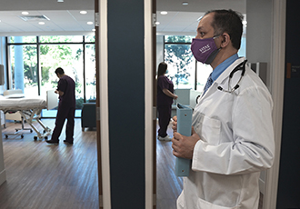 A VITAS physician walks through a hospice inpatient unit