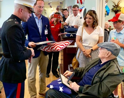 A VITAS patient with his family at a flag-folding ceremony