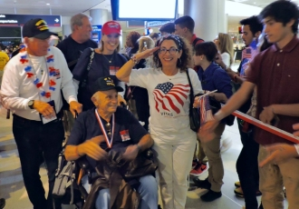 Delighted veterans upon their return from visiting war memorials in Washington, D.C.