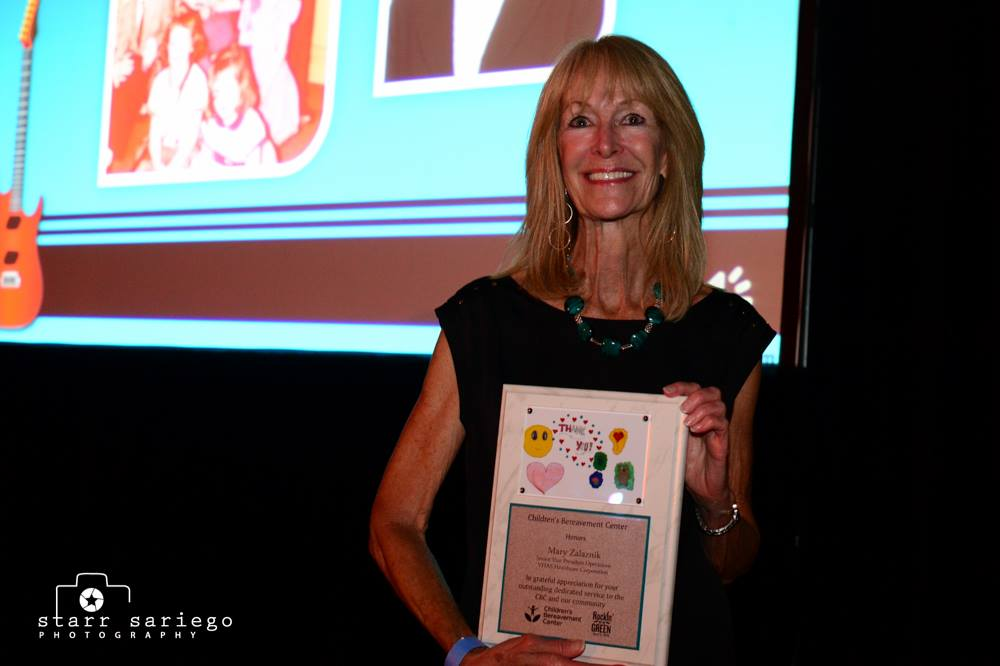 Mary Zalaznik smiling with her award