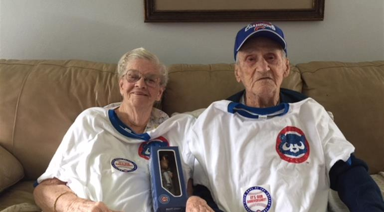 Couple wearing Cubs gear