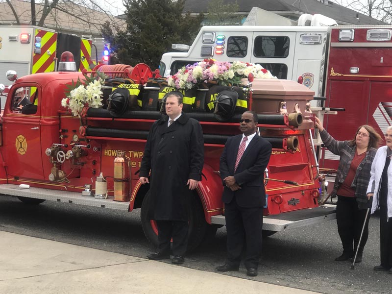 Memorial service for Ed Moore with decorated firetruck