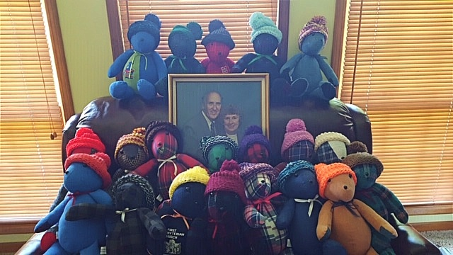 Memory Bears sewn for the Prosser family surround of photo of Henry and Marian