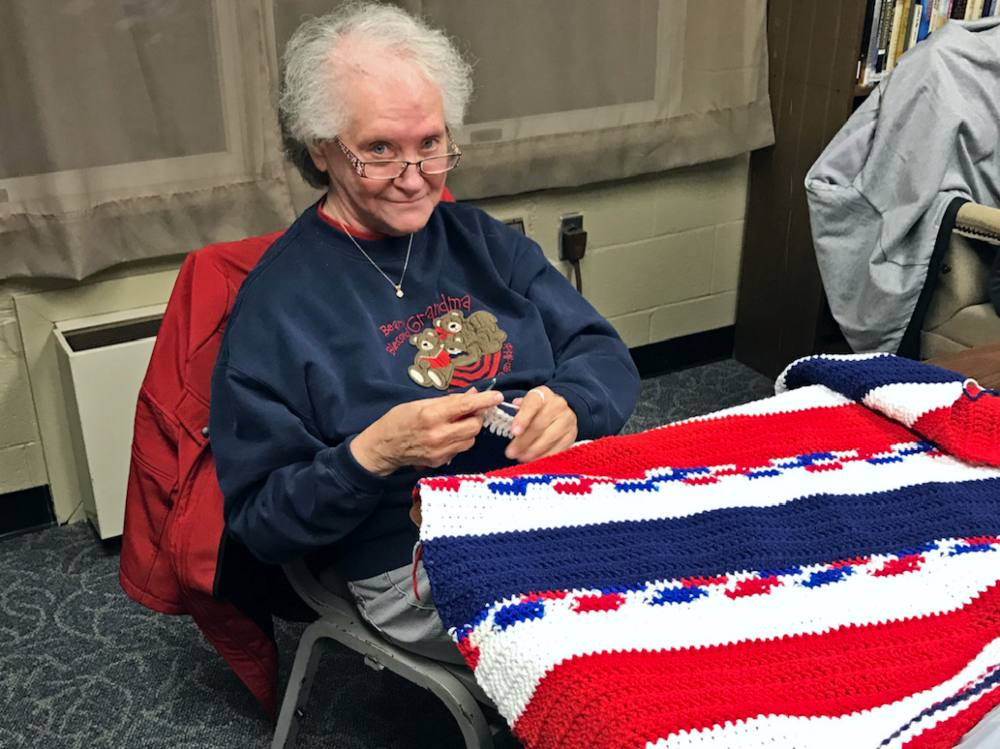 Sewing volunteer Bonnie Weil at work on a blanket
