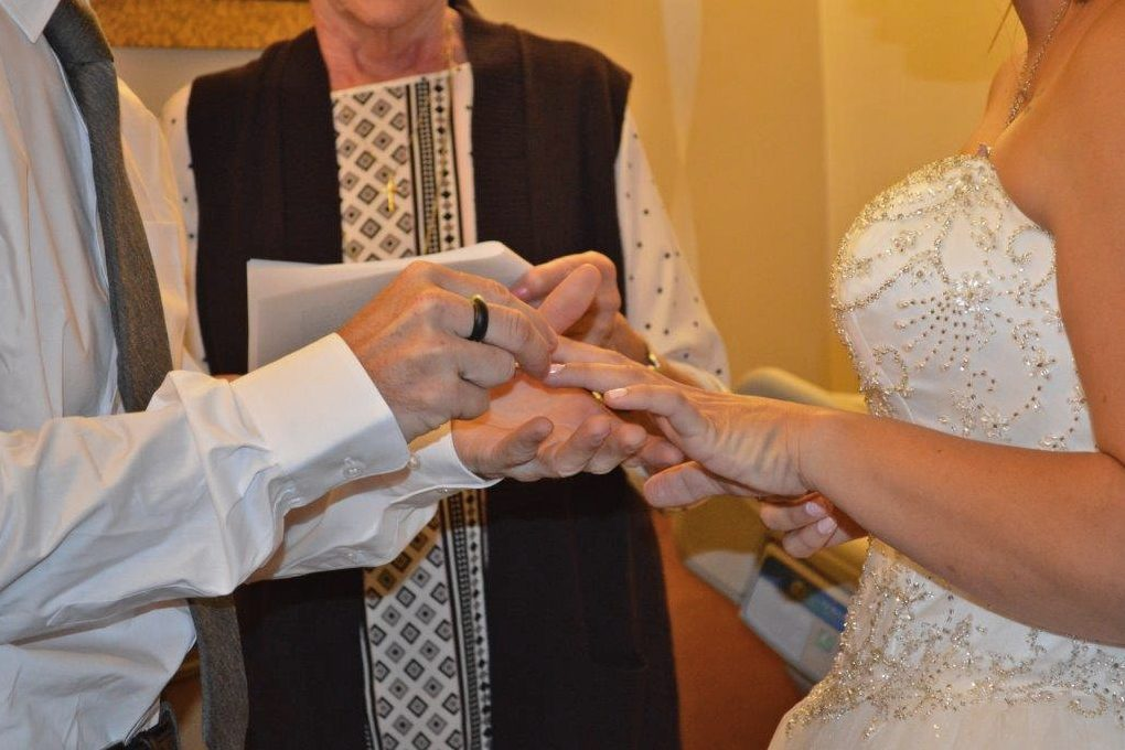 The couple exchanges rings
