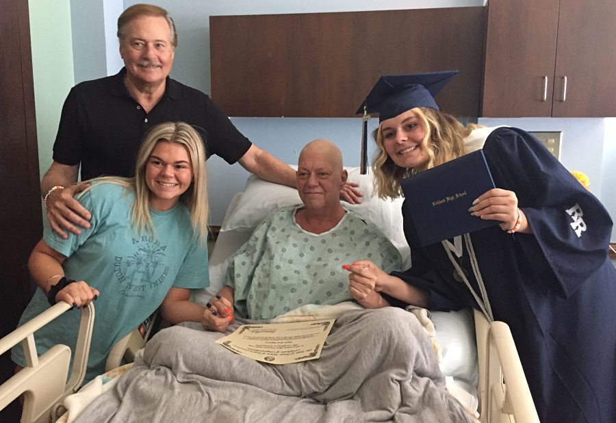 Skyler smiles with her mother, sister and father in her mother's inpatient hospice room