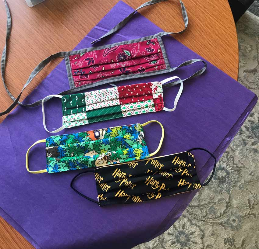 Cloth masks in a variety of patterns, sewn by VITAS volunteers for inpatient unit visitors