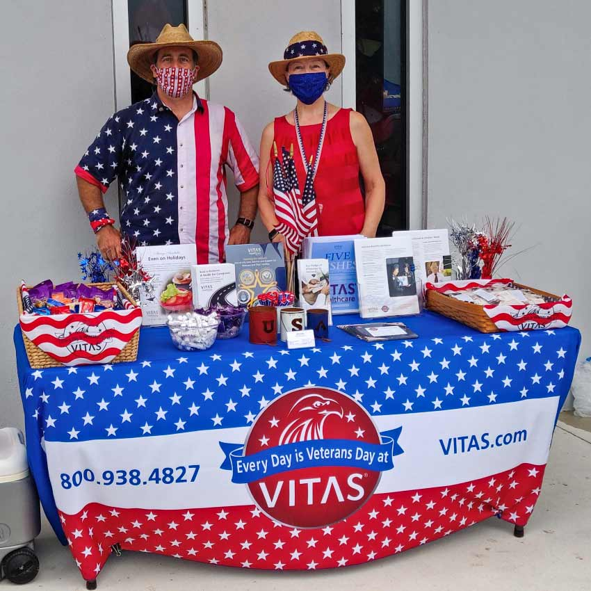 A patriotic VITAS table with educational information about honoring veterans near end of life
