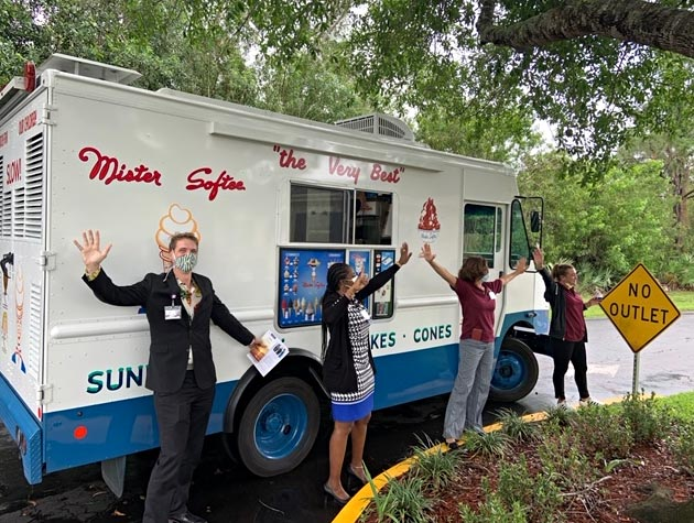 VITAS Rep Chad Adcock stands by the Mister Softee truck and welcomes healthcare workers to get a treat