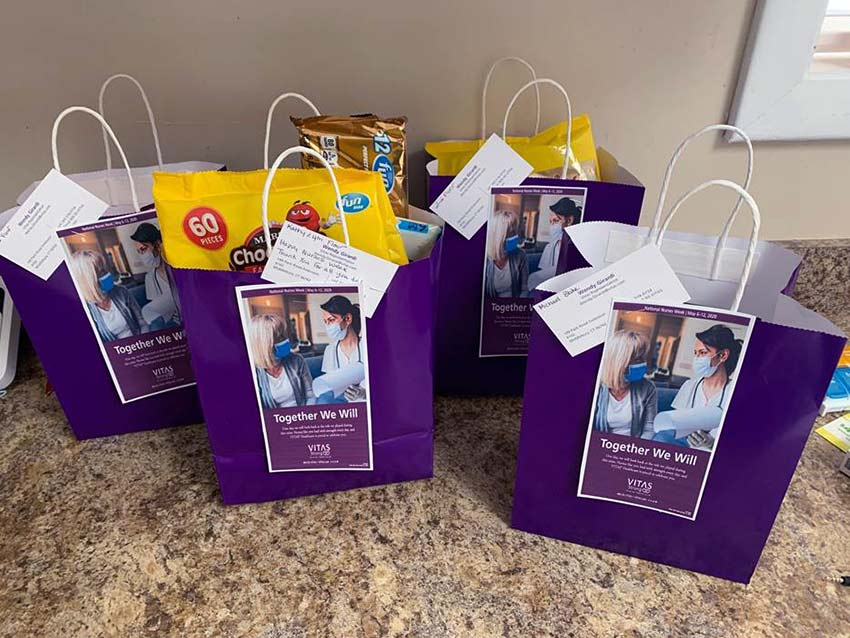 Five goody bags with candy and other treats inside