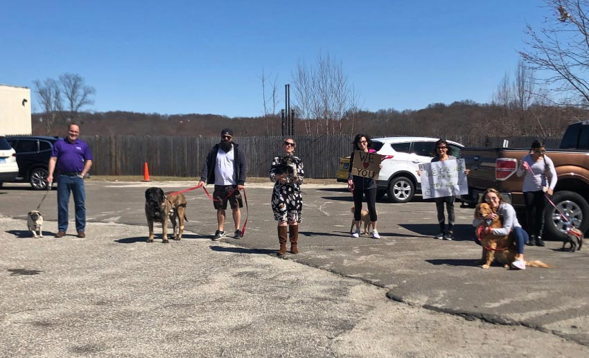 The VITAS team with their pets outside a Connecticut assisted living facility