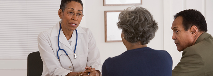 Physician discusses needs with patient and husband