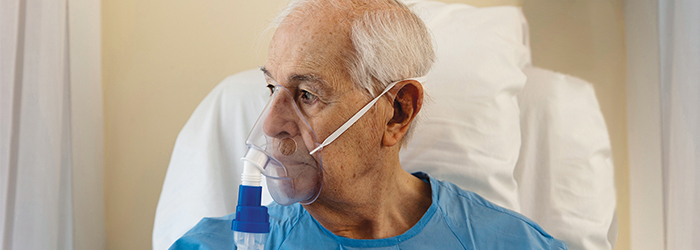 Patient in bed with oxygen mask